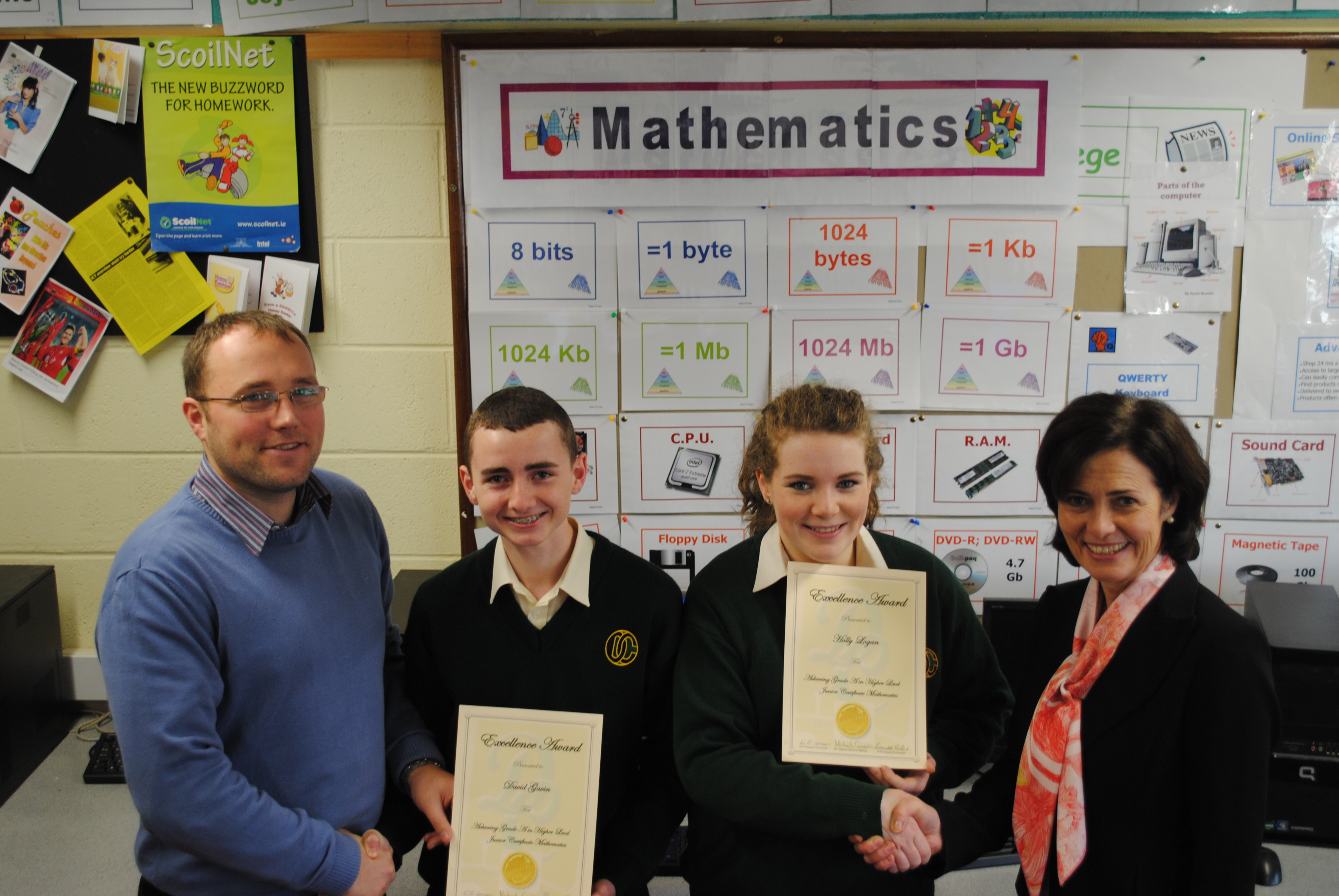 Students David Gavin and Holly Logan received an A in Junior Certificate Honours Mathematics, were presented with Certificates of Achievement from Mr. Niall O'Connor, Maths teacher and Ms. Bernie Rowland, Principal Davitt College.