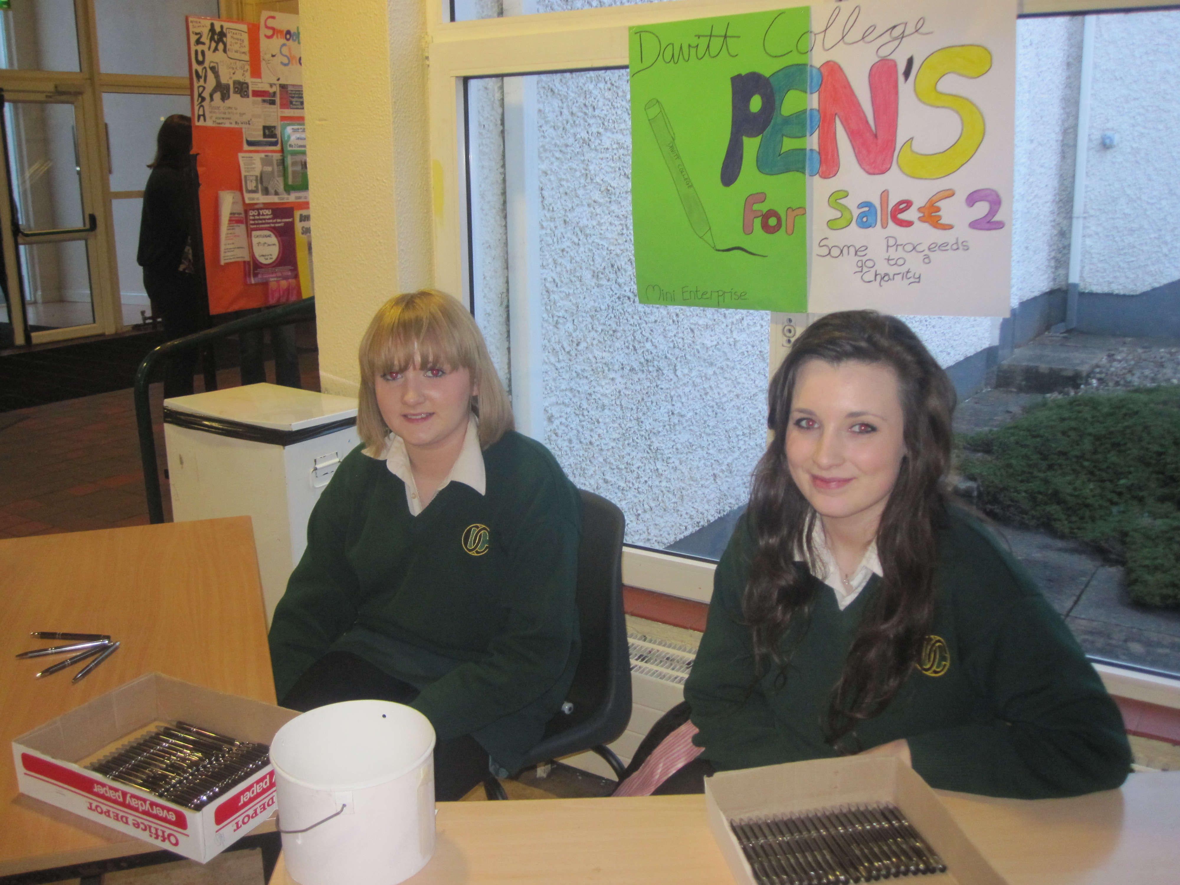 Transition Year students Melanie Nally and Roisin O'Shea selling Davitt College pens as part of their mini-company enterprise project. Pens cost €2 each!