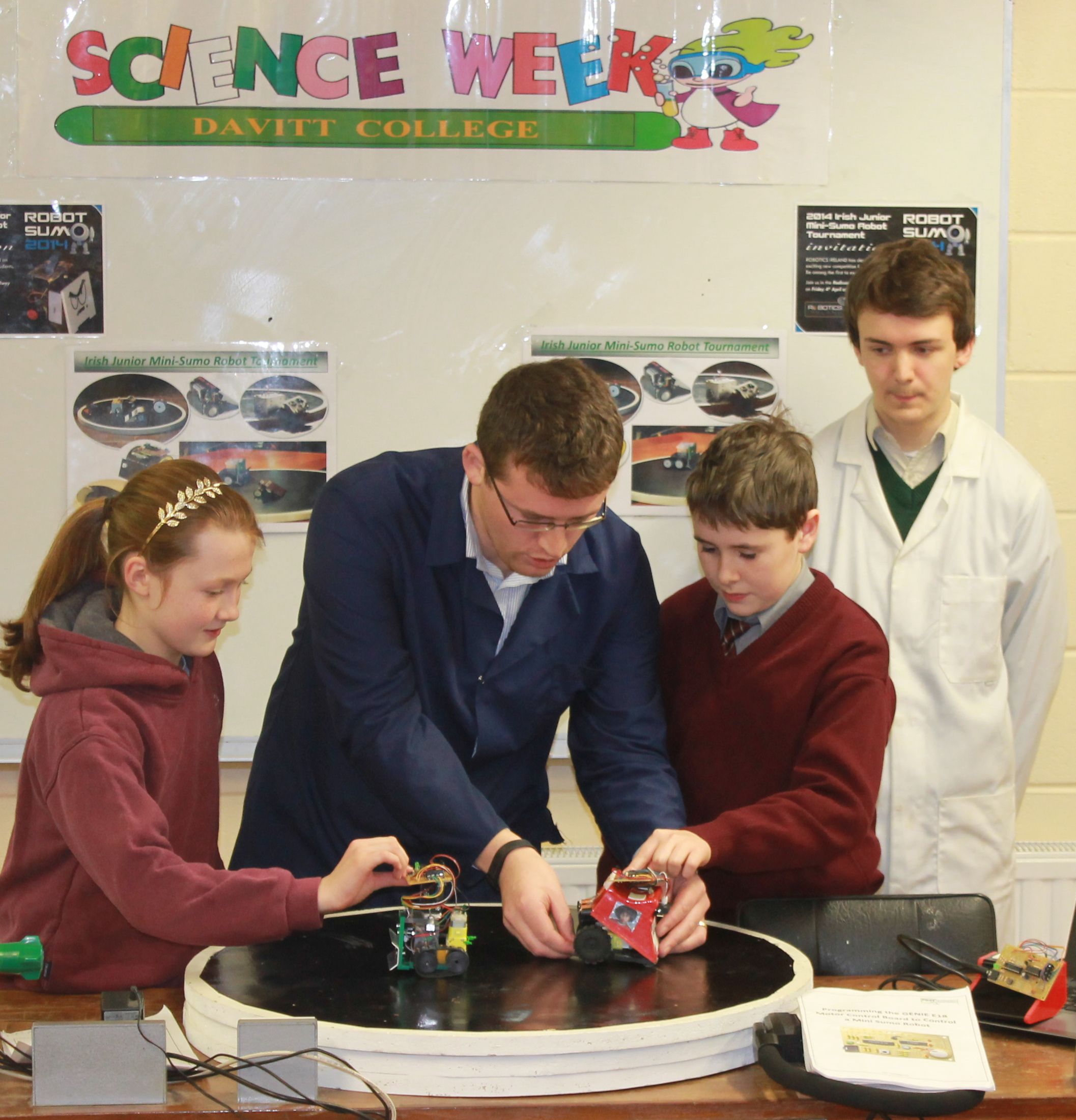 Davitt College Engineering Teacher, Mr. PJ McTavish and Transition Year Student Daniel Keighley demonstrate the team's robots to Breaffy National School students during the annual Davitt College Science and Technology Event